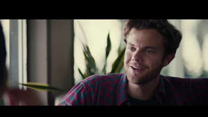 Jack Quaid looking at the camera: PLUS ONE In Theaters, VOD & Digital HD June 14th!  Starring Maya Erskine, Jack Quaid, Ed Begley Jr., Rosalind Chao, Beck Bennett and Finn Wittrock Written and Directed by Jeff Chan and Andrew Rhymer  Long-time friends Alice and Ben find themselves in that inevitable year that all late 20-somethings experience—in which seemingly every person they know gets married—and agree to be one another's plus ones as they power through an endless parade of insufferable weddings.