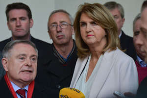 The Leader of the Labour Party, Brendan Howlin (Left), in company of his party collegues including Joan Burton (Right), speaks to the media outside Leinster House in Dublin. In Dublin, Ireland, on Friday, 24 November 2017. (Photo by Artur Widak/NurPhoto via Getty Images)