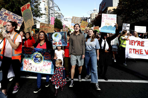 Slide 1 of 30: School children march down Queen Street during a climate change protest on May 24, in Auckland, New Zealand. Thousands of students across New Zealand are demonstrating in the streets again to fight for climate change action.