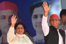 Bahujan Samaj Party (BSP) president Mayawati (L) and Samajwadi Party (SP) president Akhilesh Yadav (R) wave at the SP-BSP-RLD alliances first joint rally in Deoband in Uttar Pradesh state on April 7, 2019. (Photo by SANJAY KANOJIA / AFP)        (Photo credit should read SANJAY KANOJIA/AFP/Getty Images)