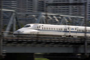TOKYO, JAPAN - APRIL 18:  A  Central Japan Railway Co. (JR Central) Shinkansen bullet train travels on April 18, 2019 in Tokyo, Japan. Japanese people are enjoying rare 10 consecutive days off beginning April 27 in the Golden Week this year as the new Emperor is planned to ascend the throne. The nation's travel industry expects an increase in bookings for trips.  (Photo by Tomohiro Ohsumi/Getty Images)