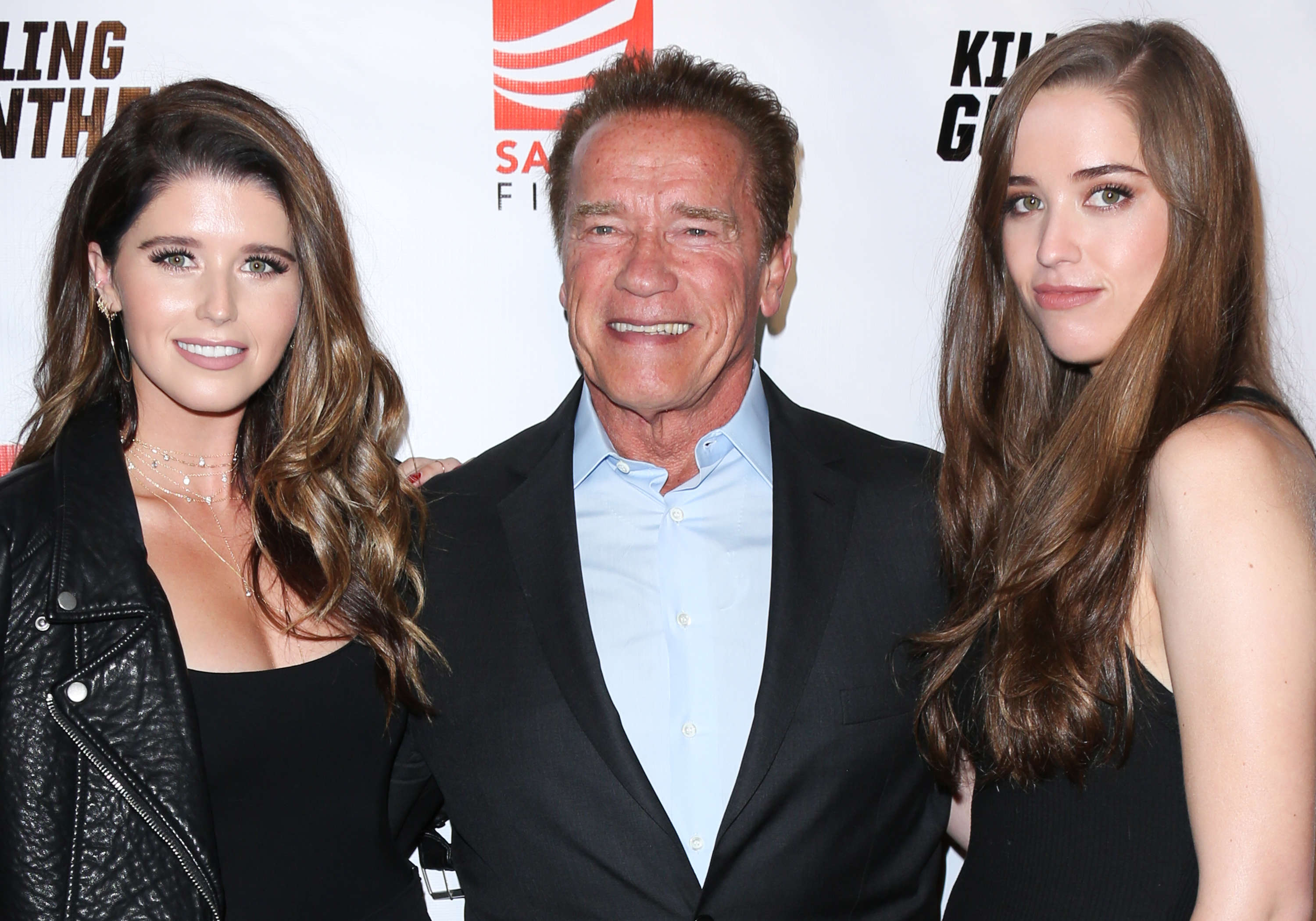 "Slide 16 of 18: HOLLYWOOD, CA - OCTOBER 14:  (L-R) Katherine Schwarzenegger, Arnold Schwarzenegger and Christina Schwarzenegger attend the premiere of ""Killing Gunther"" at The TCL Chinese Theatre on October 14, 2017 in Hollywood, California.  (Photo by Paul Archuleta/FilmMagic)"