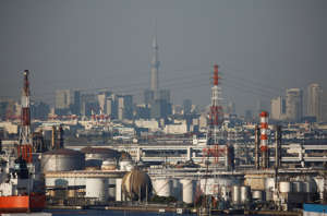 Chimneys of an industrial complex and Tokyo's skyline are seen from an observatory deck at an industrial port in Kawasaki, Japan, October 24, 2016.