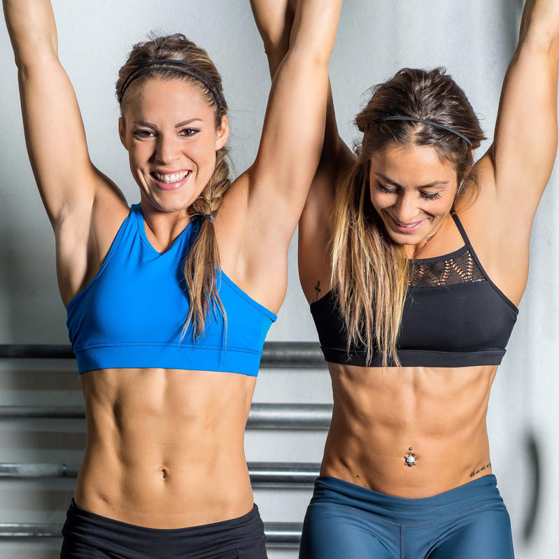 a group of people posing for the camera: What Body Fat Percentage Do You Need to See Abs? Experts Have the Answer