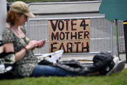 Protesters bring placards as they gather for a march calling for action to combat climate change organised by the climate campaign group Mothers Rise Up in central London on May 12, 2019. - People took to the streets in the British captial on May 12  International Mothers Day  for a march organised by Mothers Rise Up calling on the UK government to take urgent action to combat climate change. Mothers Rise Up is a campaign group that is part of the Our Kids Climate international coalition of groups demanding climate action. (Photo by Ben STANSALL / AFP)        (Photo credit should read BEN STANSALL/AFP/Getty Images)