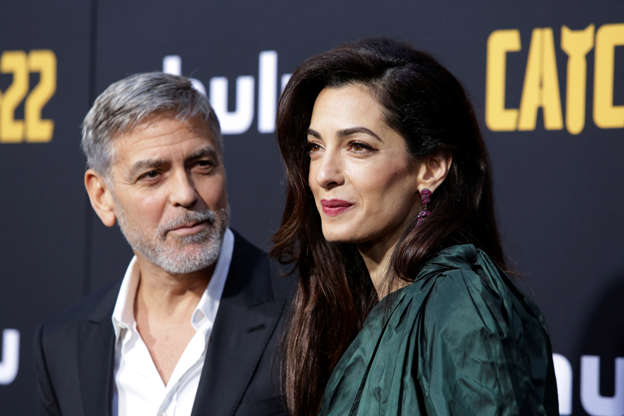 We'll drink to that! The Clooneys see their fortune grow to