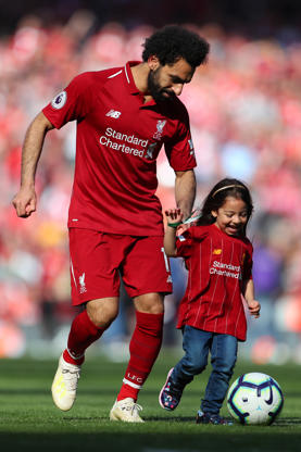 LIVERPOOL, ENGLAND - MAY 12: Mohamed Salah of Liverpool walks around his pitch with his child after the Premier League match between Liverpool FC and Wolverhampton Wanderers at Anfield on May 12, 2019 in Liverpool, United Kingdom. (Photo by Catherine Ivill/Getty Images)