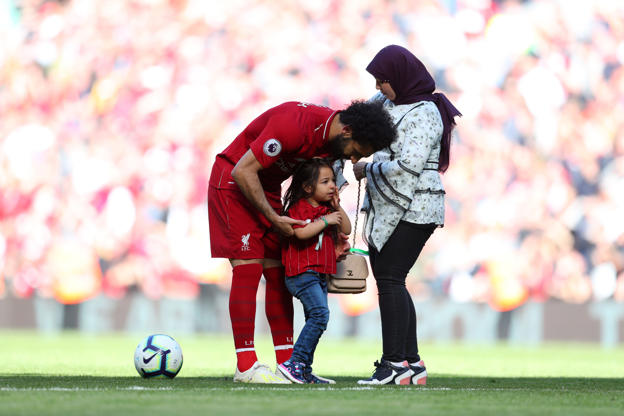 LIVERPOOL, ENGLAND - MAY 12: Mohamed Salah of Liverpool speaks to his family after the Premier League match between Liverpool FC and Wolverhampton Wanderers at Anfield on May 12, 2019 in Liverpool, United Kingdom. (Photo by Catherine Ivill/Getty Images)