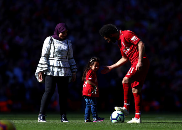 LIVERPOOL, ENGLAND - MAY 12: Mohamed Salah of Liverpool plays football with his daughter after the Premier League match between Liverpool FC and Wolverhampton Wanderers at Anfield on May 12, 2019 in London, England. (Photo by Chloe Knott - Danehouse/Getty Images)