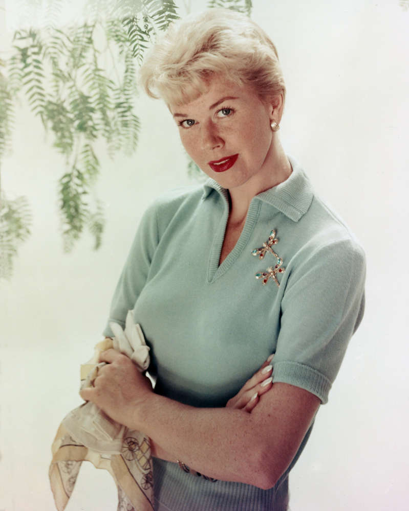 Doris Day, US actress and singer, wearing a light blue, short-sleeved woollen blouse, with two dragonfly brooches, circa 1955. (Photo by Silver Screen Collection/Getty Images)