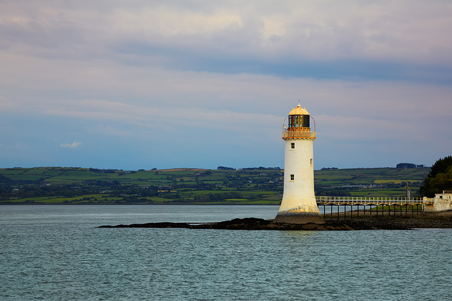 a small boat in a large body of water: Historically rainy Ireland sees its highest daytime temperatures in the month of July.