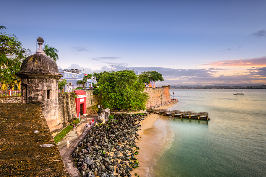 a bridge over a body of water: San Juan offers both small and larg sandy stretches to soak up the summer sun.