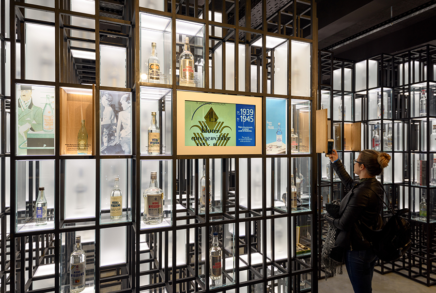 a group of people in a store: The new Polish Vodka Museum offers tastings of potato-, wheat-, and rye-based vodkas.