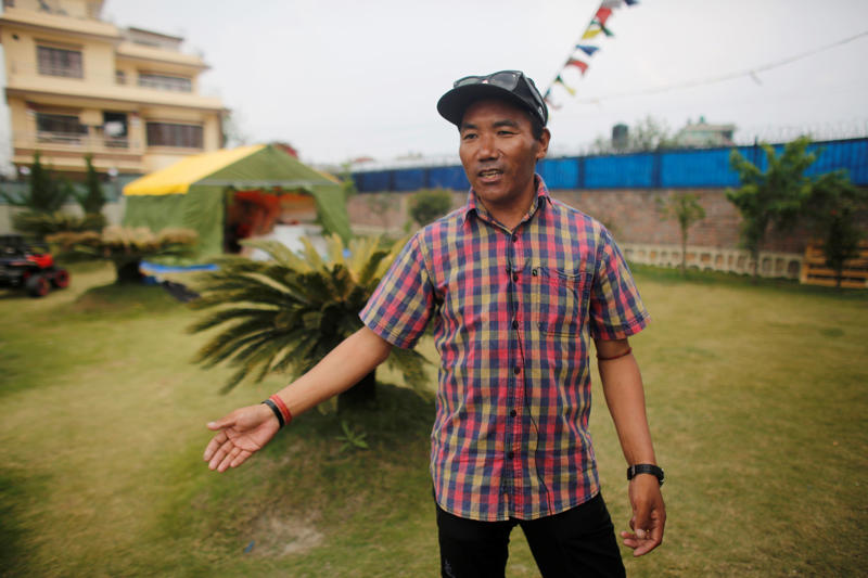 In this April 4, 2019 photo, record holding Sherpa guide Kami Rita speaks with the Associated Press in Kathmandu, Nepal.