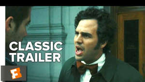 a man wearing a suit and tie: Zodiac (2007) Trailer 1: Check out the trailer starring Jake Gyllenhaal, Robert Downey Jr., and Mark Ruffalo! Be the first to watch, comment, and share old trailers dropping @MovieclipsClassicTrailers.  ► Buy or Rent on FandangoNOW: https://www.fandangonow.com/details/movie/zodiac-2007/1MV8d4919014fd62aad80991ca9805c1edd?ele=searchresult&elc=zodiac&eli=0&eci=movies?cmp=MCYT_YouTube_Desc   Watch more Classic Trailers: ► Classic Horror Films Playlist http://bit.ly/2ovE2sV  ► Classic Remade Films Playlist http://bit.ly/2nQX1eG  ► Classic Romantic Comedies Playlist http://bit.ly/2o3paBu  In the late 1960s and 1970s, fear grips the city of San Francisco as a serial killer called Zodiac stalks its residents. Investigators (Mark Ruffalo, Anthony Edwards) and reporters (Jake Gyllenhaal, Robert Downey Jr.) become obsessed with learning the killer's identity and bringing him to justice. Meanwhile, Zodiac claims victim after victim and taunts the authorities with cryptic messages, cyphers and menacing phone calls.  Subscribe to CLASSIC TRAILERS: http://bit.ly/1u43jDe We're on SNAPCHAT: http://bit.ly/2cOzfcy Like us on FACEBOOK: http://bit.ly/1QyRMsE Follow us on TWITTER: http://bit.ly/1ghOWmt  Welcome to the Fandango MOVIECLIPS Trailer Vault Channel. Where trailers from the past, from recent to long ago, from a time before YouTube, can be enjoyed by all. We search near and far for original movie trailer from all decades. Feel free to send us your trailer requests and we will do our best to hunt it down.