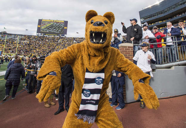 7e9a3078d053 Penn State's Nittany Lion mascot poses for a photo on the Michigan Stadium  sidelines before an