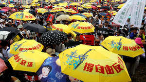 Demonstrators hold yellow umbrellas, the symbol of the Occupy Central movement, during a protest to demand authorities scrap a proposed extradition bill with China, in Hong Kong, China June 9, 2019. REUTERS/Tyrone Siu