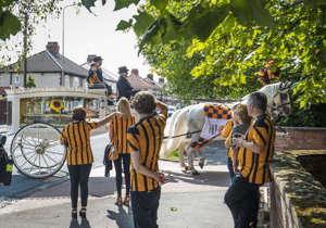 Mourners wearing Hull City shirts arrive at Chanterlands Crematorium in Hull to attend the funeral of six-year-old Stanley Metcalf, who died in a pellet gun incident.
