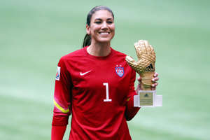 United States' Hope Solo is presented with the Adidas Golden Glove following the FIFA Women's World Cup Canada 2015 Final match between USA and Japan at BC Place Stadium in Vancouver, Canada.