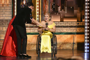 "Laura Benanti, from left, and Anthony Ramos present the award for best performance by an actress in a featured role in a musical to Ali Stroker for her performance in ""Rodgers & Hammerstein's Oklahoma!"" at the 73rd annual Tony Awards at Radio City Music Hall on Sunday, June 9, 2019, in New York. (Photo by Charles Sykes/Invision/AP)"