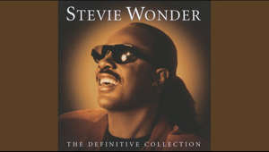 a close up of a mans face: Provided to YouTube by Universal Music Group  Isn't She Lovely · Stevie Wonder  The Definitive Collection  ℗ 1996 UMG Recordings, Inc.  Released on: 2002-10-29  Composer  Lyricist: Stevie Wonder  Auto-generated by YouTube.