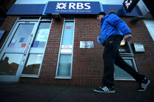 A person walks past a branch of RBS bank in Nottingham, Britain, December 1, 2017. REUTERS/Hannah McKay