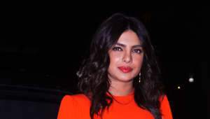 Priyanka Chopra stuns in orange dress in Mumbai