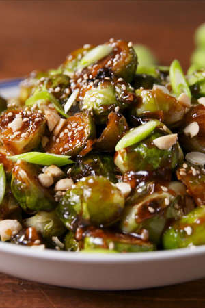 a bowl of food with broccoli: Kung Pao Brussels Sprouts vertical