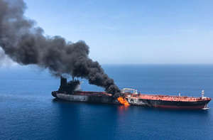 A picture obtained by AFP from Iranian News Agency ISNA on June 13, 2019 reportedly shows fire and smoke billowing from a tanker said to have been attacked in the waters of the Gulf of Oman. - Suspected attacks left two tankers in flames in the waters of the Gulf of Oman today, sending world oil prices soaring as Iran helped rescue stricken crew members. The mystery incident, the second involving shipping in the strategic sea lane in only a few weeks, came amid spiralling tensions between Tehran and Washington, which has pointed the finger at Iran over earlier tanker attacks in May. (Photo by - / ISNA / AFP)        (Photo credit should read -/AFP/Getty Images)