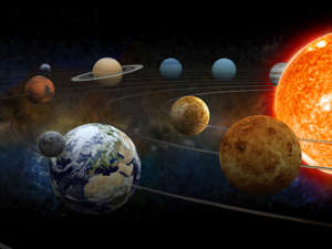 The sun and nine planets of our system orbiting.