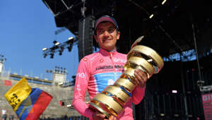 VERONA, ITALY - JUNE 02: Podium / Richard Carapaz of Ecuador and Movistar Team Pink Leader Jersey / Celebration / Trofeo Senza Fine / Trophy / Ecuadorian Flag / during the 102nd Giro d'Italia 2019, Stage 21 a 17km Individual Time Trial stage from Verona - Fiera to Verona - Arena / ITT / Amphitheatre / Arena di Verona / Tour of Italy / #Giro / @giroditalia / on June 02, 2019 in Verona, Italy. (Photo by Justin Setterfield/Getty Images)