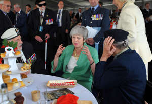Britain's Prime Minister Theresa May meets veterans during an event to commemorate the 75th anniversary of D-Day, in Portsmouth, Britain June 5, 2019. Kerry Davies/Pool via REUTERS