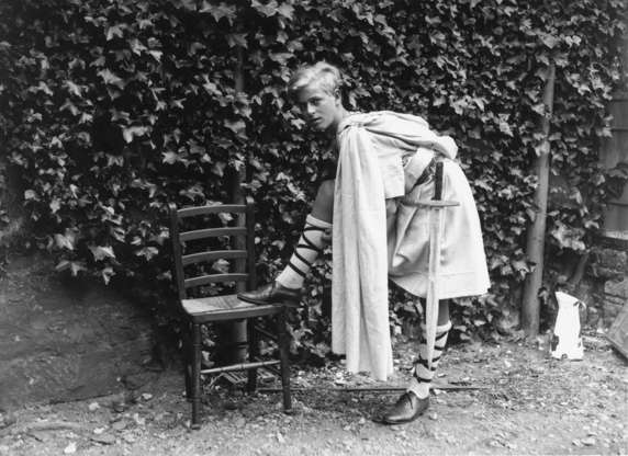 Slide 3 of 37: July 1935: Prince Philip of Greece dressed for the Gordonstoun School's production of 'MacBeth', in Scotland. (Photo by Fox Photos/Getty Images)
