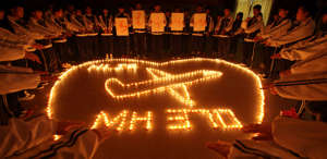 Students from an international school in east China city Zhuji pray for the passengers onboard Malaysia Airlines flight MH370 by lighting candles on March 10, 2014 in Zhuji, China. Malaysia Airline flight MH370 from Kuala Lumpur to Beijing and carrying 239 onboard was reported missing after the crew failed to check in as scheduled while flying over waters between Malaysia and Ho Chi Minh City in Vietnam.  (Photo by VCG/VCG via Getty Images)