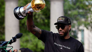 Toronto Raptors basketball player Kawhi Leonard hold his MVP trophy during the Raptors victory parade after defeating the Golden State Warriors in the 2019 NBA Finals, in Toronto, Ontario, Canada June 17, 2019.