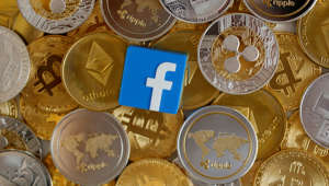 A 3-D printed Facebook logo is seen on representations of virtual currencies in this illustration picture, June 18, 2019. REUTERS/Dado Ruvic/Illustration