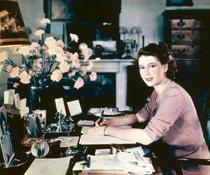 a person sitting at a desk: The Queen has been writing a nightly diary since she was a teenager.