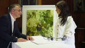 "Robot artist 'Ai-Da', described as ""the world's first ultra-realistic AI humanoid robot artist"", sketches British gallery owner and her inventor Aidan Meller in Oxford, Britain June 4, 2019. Picture taken June 4, 2019. REUTERS/Matthew Stock"