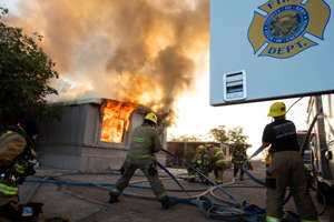 Firefighters battle an electrical fire in a mobile home park in Ridgecrest, California, on July 6, 2019 following a magnitude 7.1 earthquake on July 5.