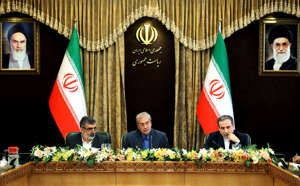 "(L to R) Iran's Atomic Energy Organisation spokesman Behrouz Kamalvandi, government spokesman Ali Rabiei, and Deputy Foreign Minister Abbas Araghchi give a joint press conference at the presidential headquarters in the capital Tehran on July 7, 2019. - Iran will begin enriching uranium beyond a 3.67 percent cap set by a landmark nuclear deal ""in a few hours"", the Islamic republic's atomic energy organisation spokesman Behrouz Kamalvandi said on July 7, 2019. The ""order received from the president"" Hassan Rouhani would be implemented in a few hours after the last technical details were sorted, Kamalvandi said live on state television. (Photo by HAMED MALEKPOUR / TASNIM NEWS / AFP)        (Photo credit should read HAMED MALEKPOUR/AFP/Getty Images)"