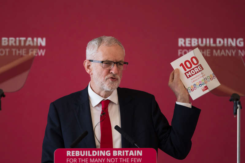 Labour Leader Jeremy Corbyn holds a labour party booklet during a speech at the Labour local government conference at The Slate, Warwick Conferences, Coventry. (Photo by Aaron Chown/PA Images via Getty Images)