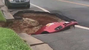 Sink hole swallows car in Virginia