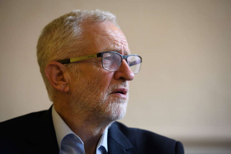 ILFORD, ENGLAND - JUNE 20: Labour Party leader Jeremy Corbyn talks with community members who moved to Britain in the 1960s and 1970s from the Caribbean islands at the Cardinal Heenen centre on June 20, 2019 in Ilford, England. This Saturday is the second annual Windrush Day when the UK honours the British Caribbean Community's contribution to British life. It was introduced in 2018 on the 70th anniversary of the landing of HMT Empire Windrush from Jamaica. (Photo by Leon Neal/Getty Images)