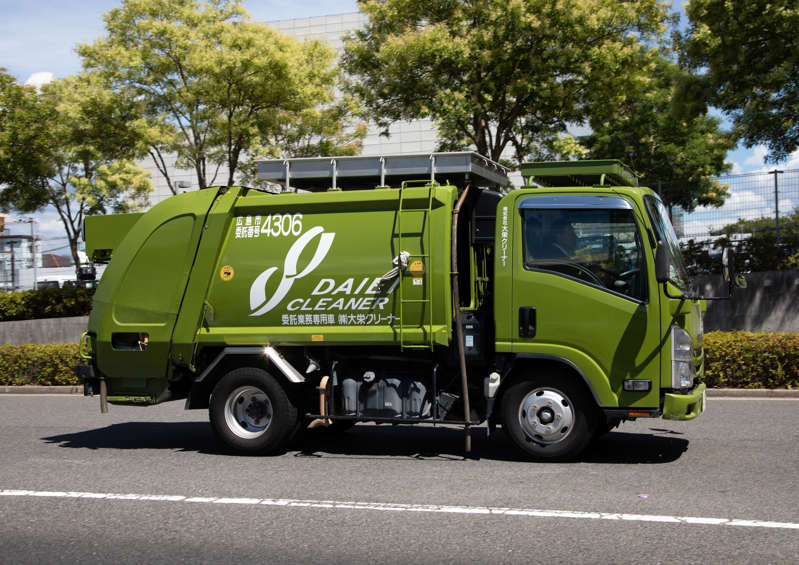 HIROSHIMA, JAPAN - AUGUST 13: Green garbage truck, Chugoku region, Hiroshima, Japan on August 13, 2018 in Hiroshima, Japan. (Photo by Eric Lafforgue/Art In All Of Us/Corbis via Getty Images)