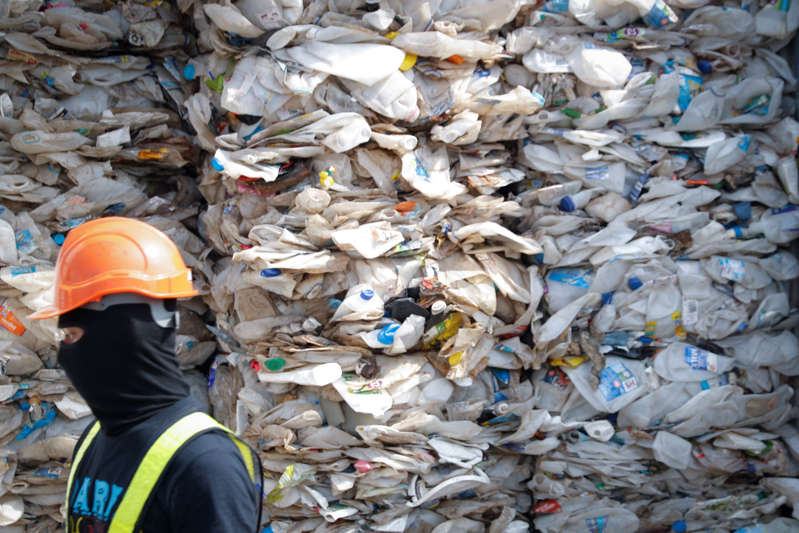 """FILE - In this Tuesday, May 28, 2019, file photo, a container is filled with plastic waste from Australia, in Port Klang, Malaysia. The practice of advanced countries such as the U.S., Canada and Japan sending their non-recyclable waste to poorer countries is """"grossly unfair"""" and should stop, Malaysian Prime Minister Mahathir Mohamad said in Tokyo Thursday, May 30, 2019. His comments came days after his government announced plans to return thousands of tons of imported plastic waste back to where it came from. (AP Photo/Vincent Thian, File)"""