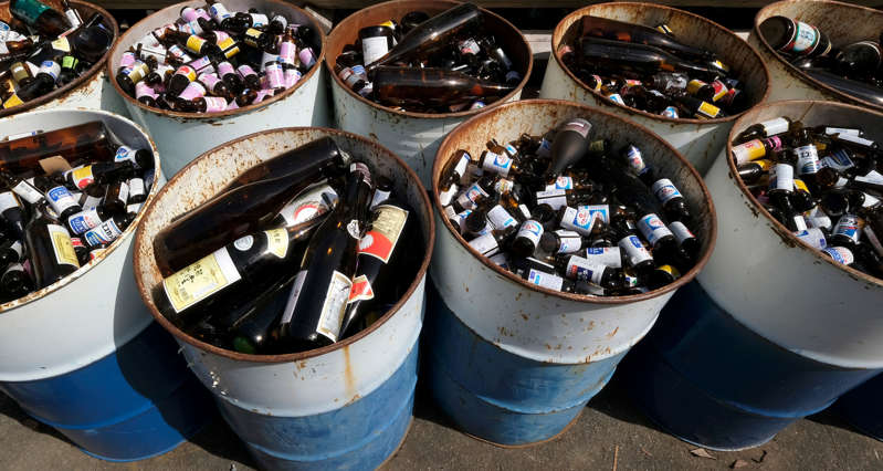 This picture taken on March 14, 2019 shows bottles separated into drums at a waste centre in the town of Kamikatsu, Tokushima prefecture. - Plastic, paper, metal? In Japan's Kamikatsu, sorting rubbish isn't that simple. Residents face a mind-boggling 45 separate categories for their garbage as the town aims to be 'zero-waste' by 2020. (Photo by Kazuhiro NOGI / AFP) / TO GO WITH AFP STORY JAPAN-ENVIRONMENT-WASTE-SYNTHETICS,FEATURE BY NATSUKO FUKUE        (Photo credit should read KAZUHIRO NOGI/AFP/Getty Images)