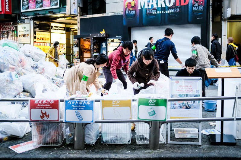 TOKYO, JAPAN - NOVEMBER 01:  Volunteers pick up garbage in Shibuya on November 1, 2018 in Tokyo, Japan. Volunteers cleaned up the streets of Shibuya where locals and foreign visitors gathered for what has become Tokyo's biggest unofficial Halloween event in the recent years . (Photo by Sawayasu Tsuji/Getty Images)