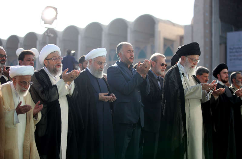 Supreme Leader of Iran, Ali Khamenei (front) leads the Eid al-Fitr Prayer at Grand Prayer Grounds (Mossalla) in Tehran, Iran on June 5, 2019. Irans Parliament Speaker Ali Larijani, Iranian President Hassan Rouhani, Ayatollah Chairman of the Assembly of Experts, Ahmad Jannati (L) and Iranian President of the Judiciary Sadeq Larijani (L-2) attended the prayer. Muslims around the world celebrate Eid al-Fitr marking the end of the holy fasting month of Ramadan.