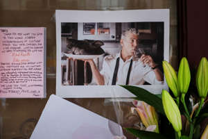 FILE: Notes, photographs and flowers are left in memory of Anthony Bourdain at the closed location of Brasserie Les Halles, where Bourdain used to work as the executive chef, June 8, 2018 in New York City. Bourdain, a writer, chef and television personality, was found dead in his hotel room in France on Friday. His employer CNN confirmed the death as a suicide.
