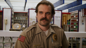 David Harbour standing in front of a building: 